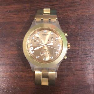 Gold Swatch watch